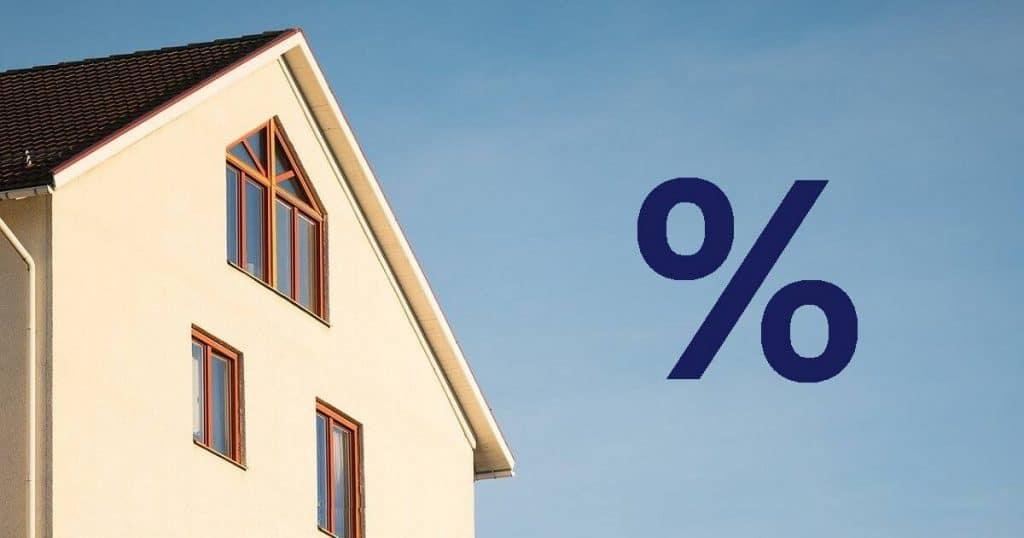 Kuvituskuva, jossa näkyy kerrostalo sekä prosenttiyksikön tunnusmerkki.